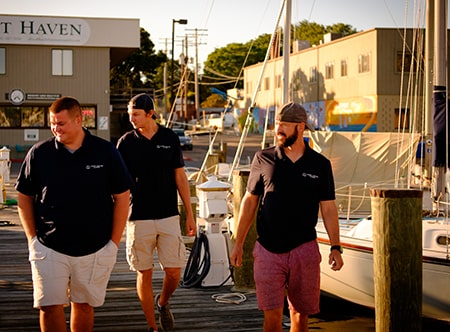 Marine Electric Systems Team Walking on Dock